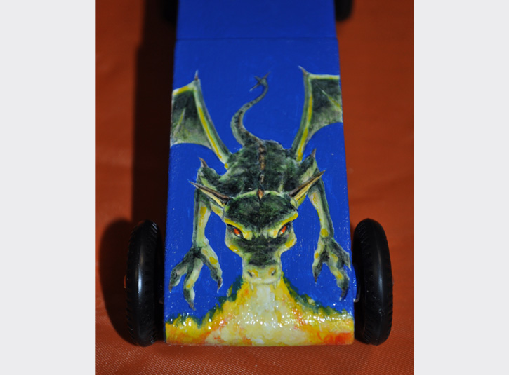 Custom paint job for my younger son's Pinewood Derby Car. Sadly, the fire-breathing dragon didn't move as fast as the previous year's car. Acrylic paint on wood.